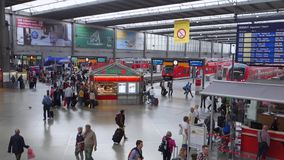 Train Station in Munich. Passengers Travellers Tourists arriving and departing at Munich Train station, Munich, Germany, Europe stock footage