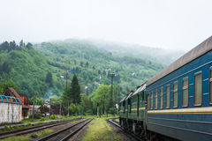 Train in the station near mountain Stock Image