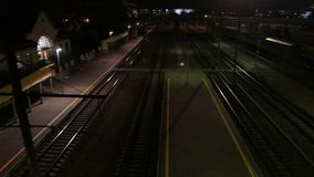 Train station at night. 4K UHD. Native video stock video footage