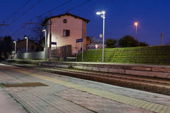 Train station at night in rome. Night view of railways in a train station in rome, italy Royalty Free Stock Image
