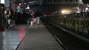 Train station in the night time in Mumbai. MUMBAI, INDIA - 12 JANUARY 2015: Train station in the night time in Mumbai stock video footage
