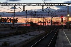 Train station with palms during sundown stock photo
