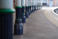 Train station platform. Cast iron columns on train station platform, shallow DOF, focus on second column stock photos