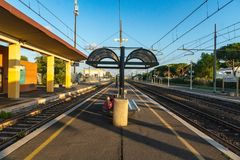 Train station platform. Empty railway station platform early in the morning royalty free stock photography