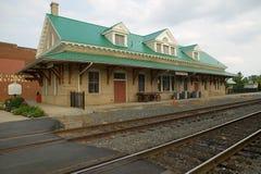 Train station and railroad tracks Royalty Free Stock Photos