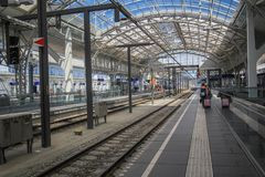 Train station at Salzburg. Train station in Salzburg Austria with mirror roof and walking passenger Royalty Free Stock Photo