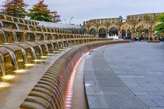 Train Station Sheffield Yorkshire. The stone façade of Sheffield station and the water cascading from steps royalty free stock photo