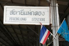 The train station sign of the Maeklong station in Samut Songkram, Thailand. Stock Photos