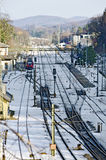 Train station with snow-covered track layout Royalty Free Stock Images