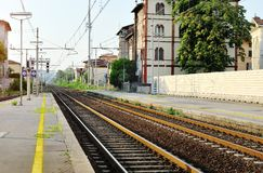 Train station and steel railway tracks, Italy Stock Images