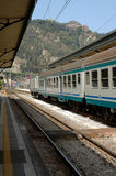 Train Station In Taormina, Sicily. Train sitting in station in Taormina, Sicily with mountain in background Stock Image