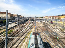 Train station, with train stopped and railway line.  stock photos