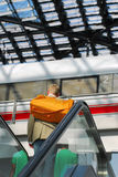 Train station, travel. A tourist on an escalator, going to train stock image