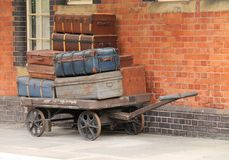 Train Station Trolley. A Traditional Train Station Trolley Holding Suitcases Royalty Free Stock Images