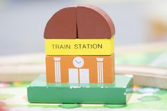 Train Station Wooden Toy Set and Street Signs Play set Education. Al toys for preschool indoor playground selective focus Stock Photo