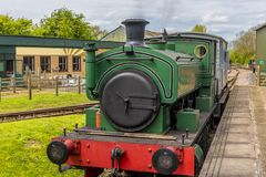 A steam train at a station in Rutland, UK. A train stationary getting up steam at a station in Rutland, UK in early autumn stock photography