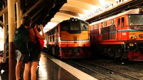 Train stations in Thailand have many tourists. stock image