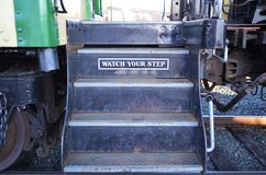 Train Steps - Watch Your Step. Steps of a steam engine train warning to watch your step royalty free stock photography