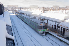 Train stop at railway station with snow of winter in Japan. Stock Photography