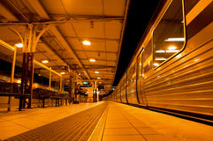 A train stopped at the platform,train station. A train stopped at train platform station at night, Melbourne Australia, Melbourne flinders Stock Photography