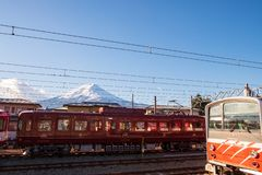 Train stopped in the station with a back view of Mount Fuji. The train stopped in the station with a back view of Mount Fuji royalty free stock images