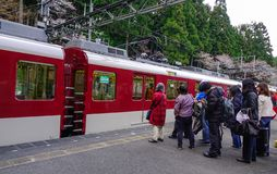 Train stopping at railway station royalty free stock photography