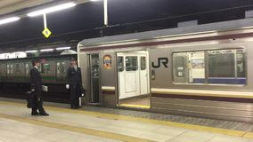 The train stopping at Shinawa station in Tokyo, Japan. The JR train stopping at Shinawa station in Tokyo, Japan stock video