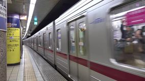 A train stopping at the subway station in Tokyo, Japan. A train stopping at the Ueno subway station in Tokyo, Japan stock footage