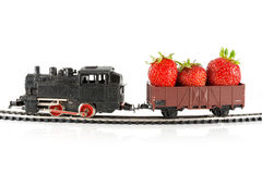 Train with strawberries Stock Images