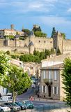 Train at strret in Carcassone against medieval fortress, it was added to the UNESCO list of Worl. CARCASSON, FRANCE - JULY 7, 2016: Train at strret in Carcassone royalty free stock photography