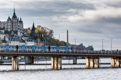 The train of the subway goes on the center of Stockholm in clear autumn day Stock Photos