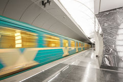 A train in a subway station. Moving train at metro station Stock Photos