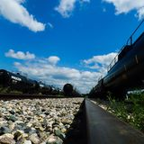 Train on a sunny day. Train, clouds, blue skies Royalty Free Stock Image