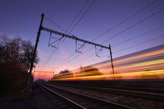 Train at the sunrise Stock Photos