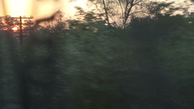 Train Sunrise View. Travelling by train view of beautifull sunrise landscape stock footage