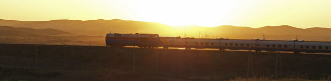 Train at sunset. Fast train at sunset went into path Stock Image