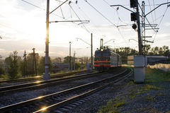 Train at sunset. Photo of the approaching train in the sun at sunset Royalty Free Stock Photo