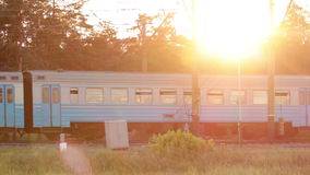 Train at sunset with sunbeam stock footage