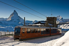 Train in Swiss Alps. A train from the Zermatt village to Gornergrat. Matterhorn on the left. Swiss Alps Royalty Free Stock Photography
