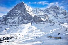 Train in swiss ski alpine mountain resort under Eiger peak, Grindelwald, Switzerland Royalty Free Stock Photo