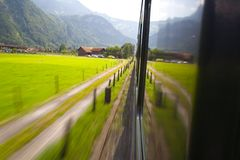 Train in Switzerland. A shot from the window of a train in Swiss Stock Photo