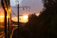 The train takes me into the sunset. stock photography