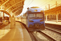 """Train of. """"TerraSur"""" company departs from central railway station at sunset on February 20, 2013 in Santiago, Chile Royalty Free Stock Images"""