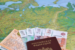 The train ticket, money and the Russian passport lie on a map of Russia Stock Photography