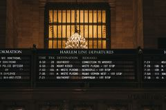 Train times and Harlem trains departure board inside Grand Central Terminal, New York, USA. Train times and Harlem trains departure board inside Grand Central stock photography
