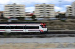 Train to Barcelona panning shot. Vilafranca del Penedès, Spain - February 28, 2016: Panning shot of a RENFE train going to Barcelona (Catalonia, Spain Royalty Free Stock Photo