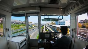 Beautiful Japantrain with cherry blossom. Train to cherry blossom park in Japan. View from the cockpit with beautiful cherry blossom along the Expo `70 stock video