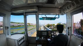 Train to cherry blossom park in Japan. View from the cockpit with beautiful cherry blossom along the Expo `70 Commemorative Park. Train driver driving to Osaka stock video footage