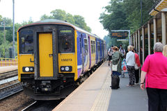 Train to Liverpool Lime Street at Huyton station Stock Photo
