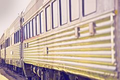 Train to Nowhere. Vintage Passenger Train Carts in Ultraviolet Color Grading royalty free stock photos